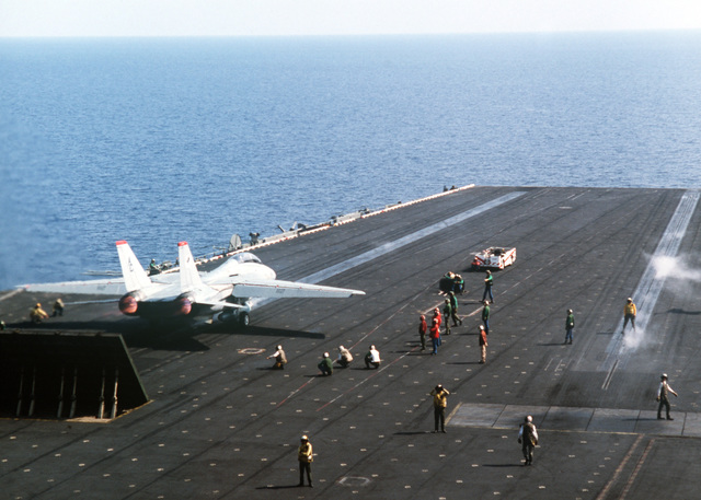 A Fighter Squadron 14 (VF-14) F-14A Tomcat aircraft is launched from the aircraft carrier USS JOHN F. KENNEDY (CV 67) during NATO Exercise DISPLAY DETERMINATION '86
