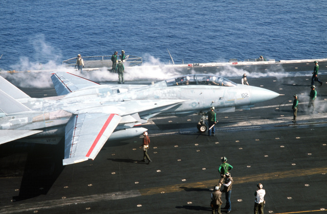 A Fighter Squadron 14 (VF-14) F-14A Tomcat aircraft is positioned on a catapult aboard the aircraft carrier USS JOHN F. KENNEDY (CV 67) during NATO Exercise DISPLAY DETERMINATION '86