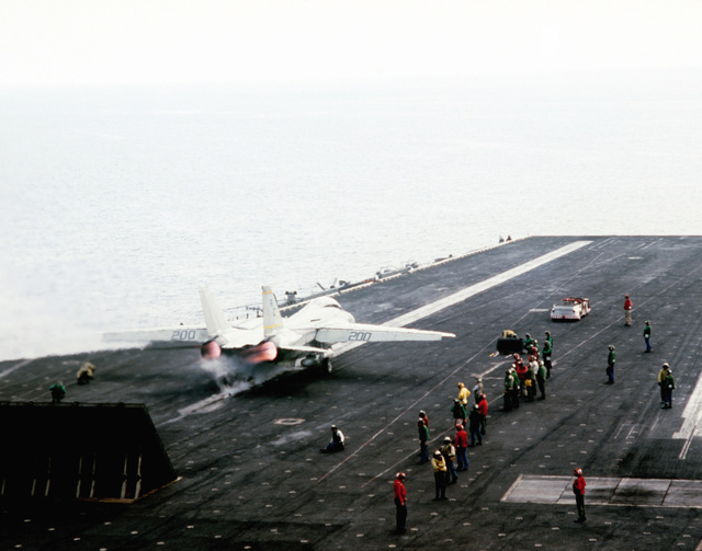 A Fighter Squadron 32 (VF-32) F-14A Tomcat aircraft is launched from the aircraft carrier USS JOHN F. KENNEDY (CV 67) during NATO Exercise DISPLAY DETERMINATION '86