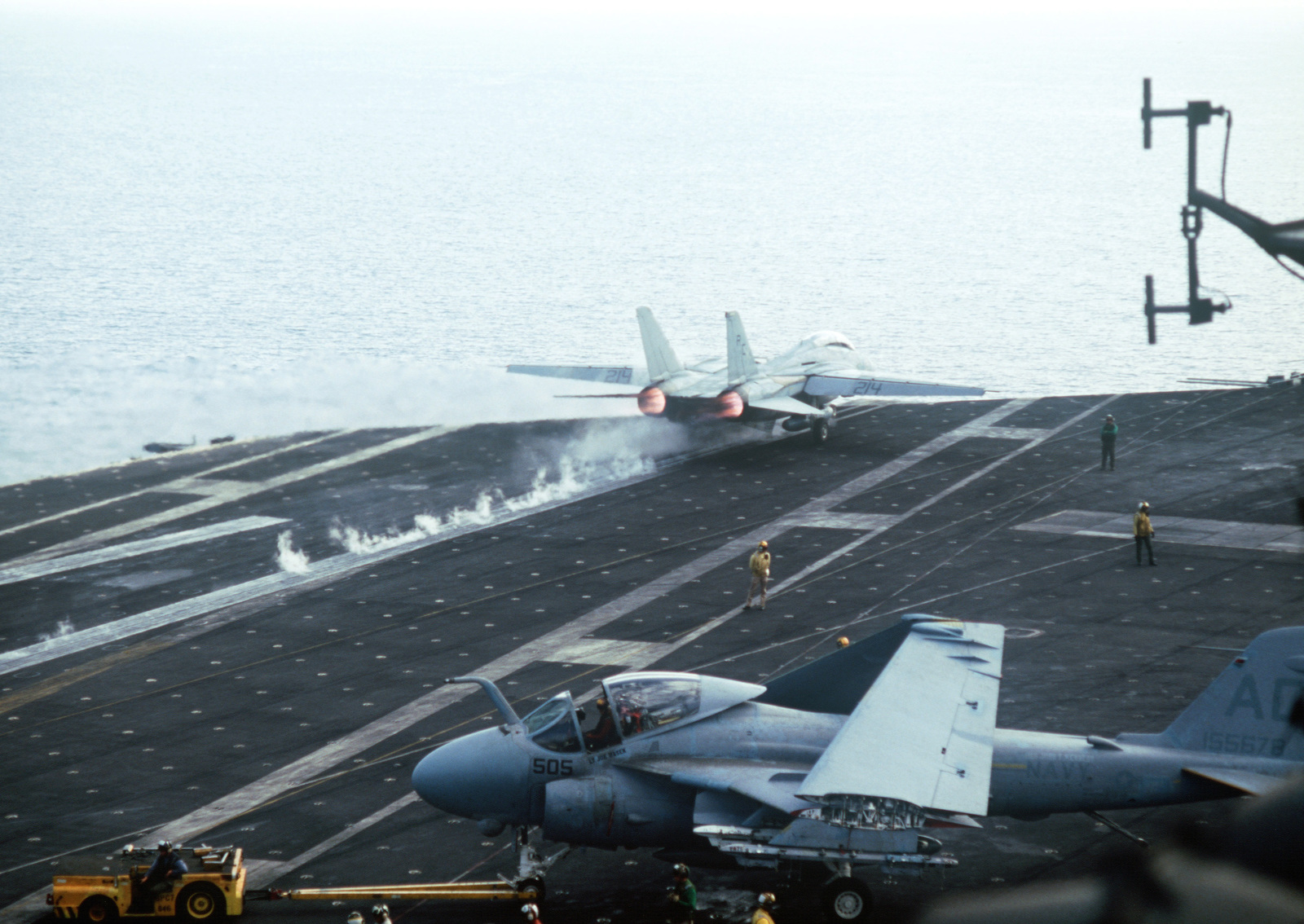 A Fighter Squadron 32 (VF-32) F-14A Tomcat aircraft is launched from the aircraft carrier USS JOHN F. KENNEDY (CV 67) during NATO Exercise DISPLAY DETERMINATION '86. An A-6E Intruder is being towed by an MD-3A