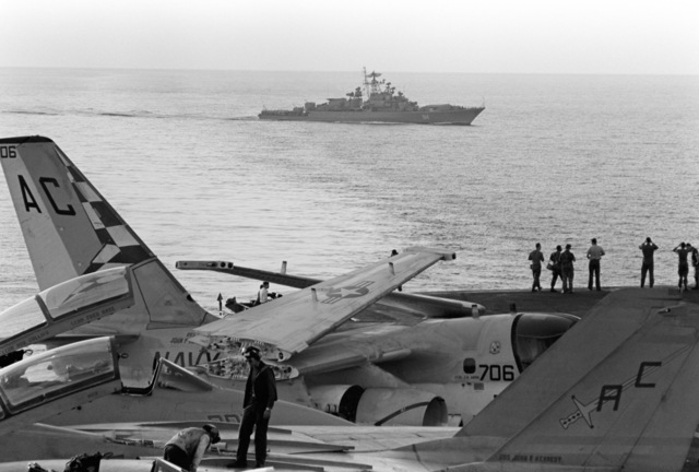 A port beam view of a Soviet Krivak class guided missile frigate observing the aircraft USS JOHN F. KENNEDY (CV 67) during NATO Exercise DISPLAY DETERMINATION '86