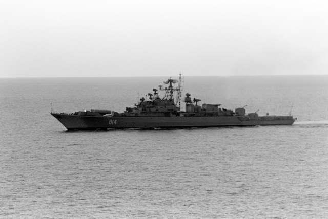 A starboard bow view of a Soviet Krivak class guided missile frigate as seen from the flight deck of the aircraft carrier USS JOHN F. KENNEDY (CV 67). The Soviet ship is observing US and Allied ships during NATO Exercise DISPLAY DETERMINATION '86