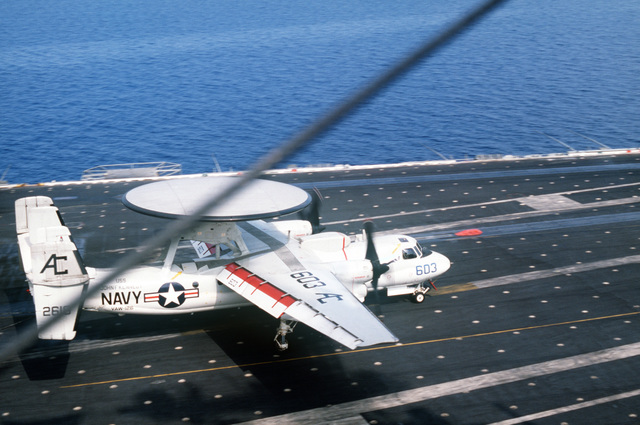 An Airborne Early Warning Squadron 126 (VAW-126) E-2C Hawkeye aircraft comes to a stop after engaging an arresting wire aboard the aircraft carrier USS JOHN F. KENNEDY (CV 67) during NATO Exercise DISPLAY DETERMINATION '86