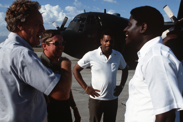 From left to right, Leslie Powers, director of Reach Out to Haiti, Inc., Major (MAJ) Ogburn, 357th Tactical Airlift Squadron (TAS), STAFF Sergeant (SSGT) Frantz J. Legrow, US Embassy, and Francoise Fouchard Bergrome, governor of the Saint Marc province, discuss the shipment of medical supplies and equipment which has just arrived from the United States by the 357th TAS