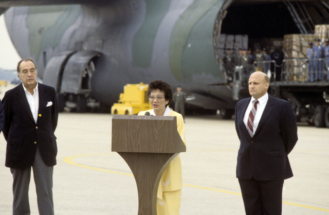 Philippine President Corazon Aquino, speaks during a ceremony honoring US Air Force efforts to supply humanitarian aid to the people of the Philippines. The US Assistant Secretary of Defense for International Security Affairs Richard L. Armitage stands to her left