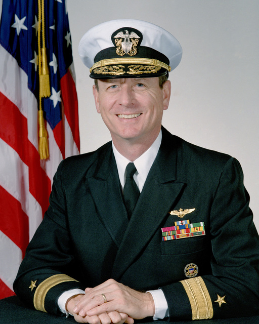 Rear Admiral (RDML) (lower half) Eric A. McVadon, USN (covered)