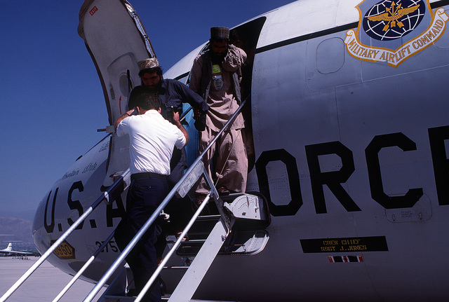 Afghan guerrillas that were chosen to receive medical treatment in the United States exit from a 375th Aeromedical Airlift Wing C-9A Nightingale MEDEVAC aircraft