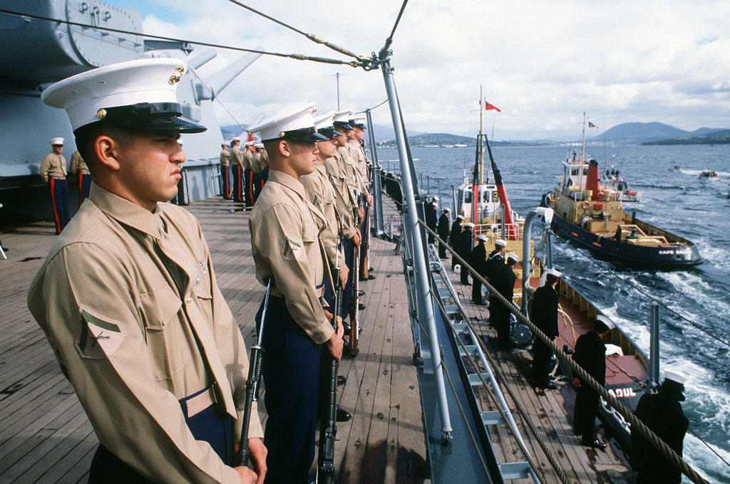 US Marines man the rail as the battleship USS MISSOURI (BB 63) leaves port. The ship is en route to Hobart, Tasmania, during its cruise around the world