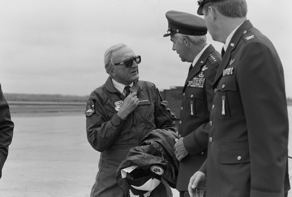 General John T. Chain Jr., Commander in CHIEF, Strategic Air Command, center, and Colonel Robert W. Parker, 321st Strategic Missile Wing Commander, welcome Lord Peter Carrington, Secretary General of the North Atlantic Treaty Organization, left, to the base