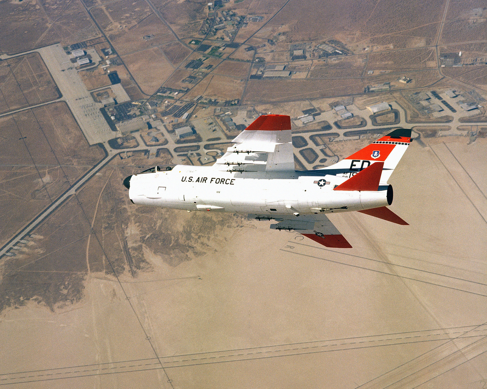 An air-to-air left side view of an A-7 Corsair II aircraft over Edwards Air Force Base