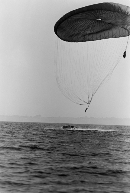 A parachute carrying airdropped equipment is retrieved during an Explosive Ordnance Disposal (EOD) Team/Sea-Air-Land (SEAL) Team joint parachuting exercise near Naval Air Station, Rota, Spain
