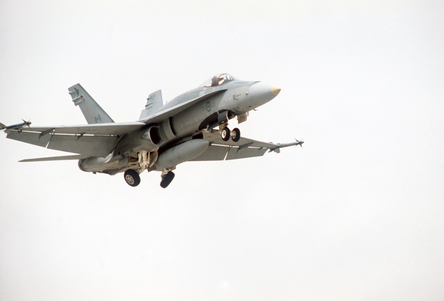 A Canadian CF-18 Hornet aircraft lowers its landing gear upon its arrival at the base for the air-to-air weapons meet WILLIAM TELL '86