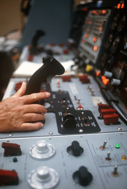 A view of the pilot control joystick and the drone aircraft control panel inside the drone radar approach control van. The van is handling take-off, flight, and landing for the QF-100 Super Sabre aircraft within a 15-mile radius during the air-to-air weapons meet WILLIAM TELL '86