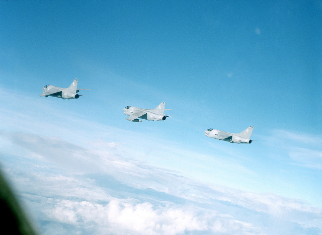 An air to air left side view of three Attack Squadron 86 (VA-86) A-7E Corsair II aircraft flying in formation