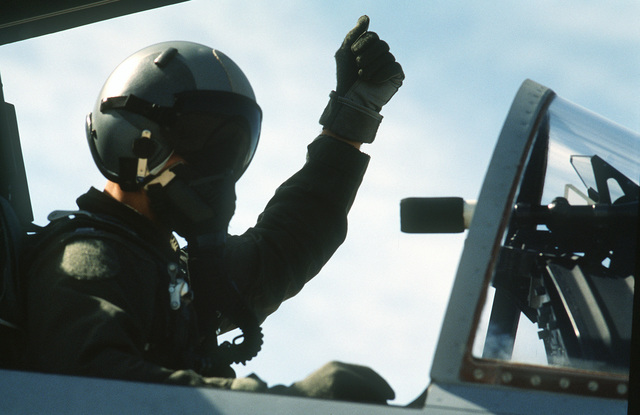 CAPT. Bruce Netardus, a 33rd Tactical Fighter Wing F-15 aircraft pilot, gives the thumbs-up sign from the cockpit of his aircraft before flying the last sortie of the air-to-air weapons meet William Tell '86