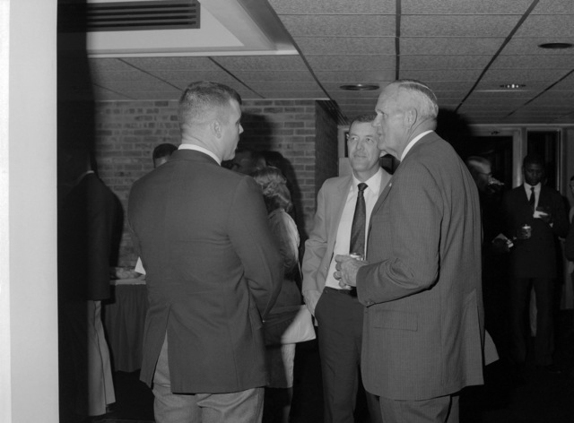 "Retired General (GEN) Louis H. Wilson Jr., a former commandant of the Marine Corps, talks with members of the Basic School staff at a reception following his""memories lecture""to students of the school"