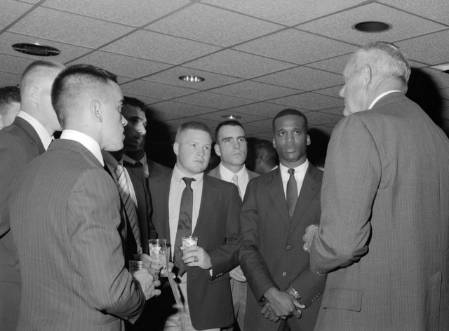 "Retired General (GEN) Louis H. Wilson Jr., a former commandant of the Marine Corps, speaks with some young lieutenants, students at the Basic School, at a reception following his""memories lecture""to the students"