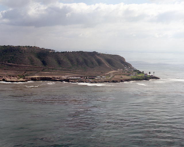 An oblique aerial view, west looking east, of Point Loma with the Point Loma lighthouse visible to the right