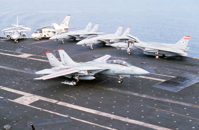 An F-14A Tomcat aircraft lands aboard the aircraft carrier USS JOHN F. KENNEDY (CV 67) during NATO Exercise DISPLAY DETERMINATION '86