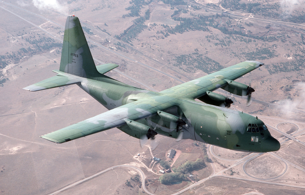 An air-to-air right front view of a 731st Tactical Airlift Squadron C-130B Hercules aircraft