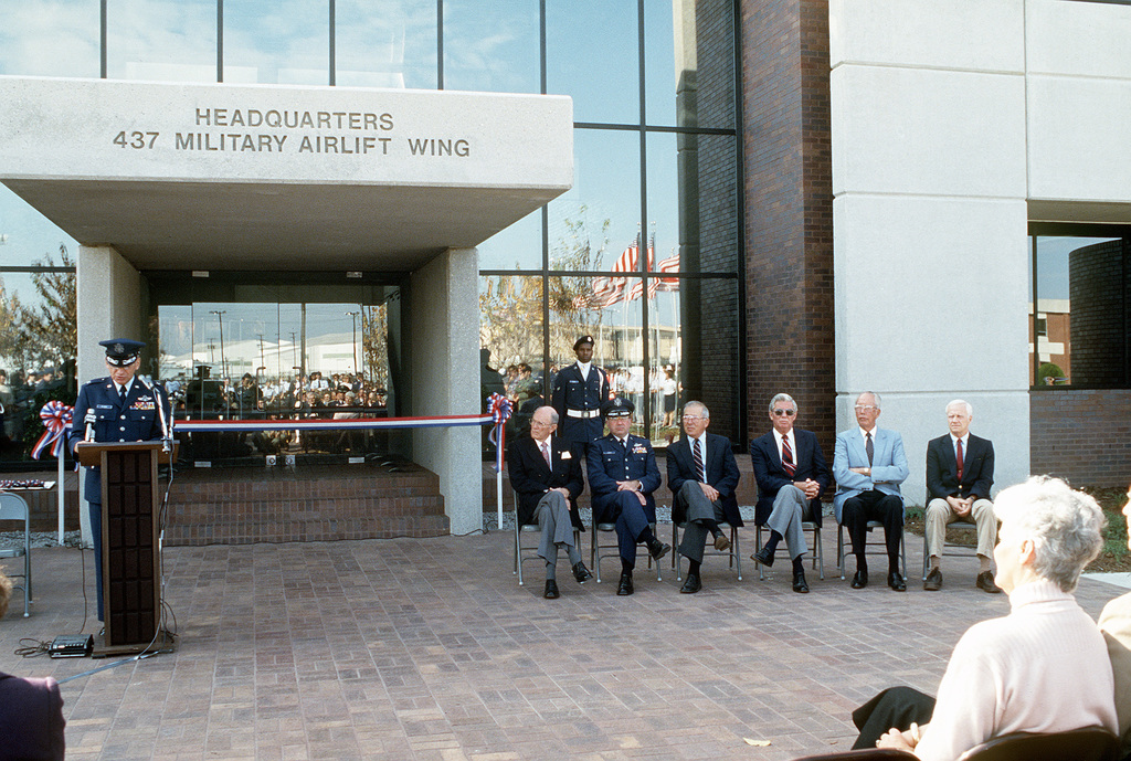 COL. James C. McCombs, Commander, 437th Military Airlift Wing, introduces distinguished guests during the dedication ceremony of the new 437th Military Airlift Wing Headquarters building