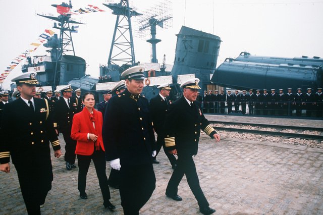 Admiral (ADM) Xinchun Ma, commander of the Chinese North Fleet, accompanies ADM James A. Lyons Jr., commander in chief, US Pacific Fleet, on a tour of US and Chinese ships. This is the first visit by US Navy ships to China in 40 years