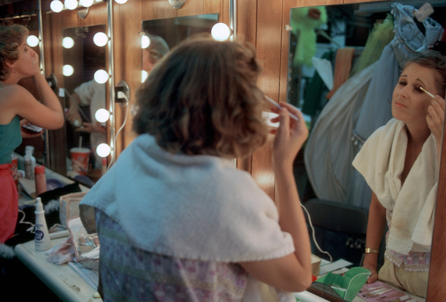 An actress applies make-up for her performance in the US Navy Band's Silver Anniversary Lollipop Concert
