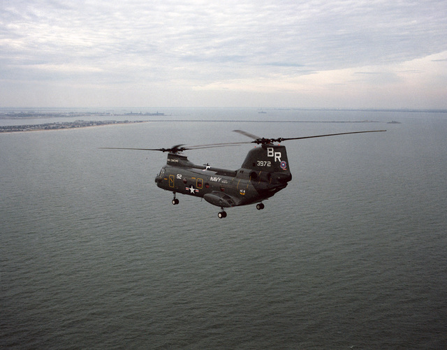 An air to air left side view of a Helicopter Combat Support Squadron 8 (HC 8) CH-46 Sea Knight helicopter from the combat stores ship USS CONCORD (AFS 5)