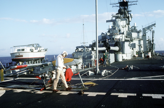 Crew members perform a final pre-launch check on a Pioneer I remotely-piloted vehicle (RPV) on the stern of the battleship USS IOWA (BB-61). The RPV, which carries a stabilized television camera and a laser designator, is being tested aboard the IOWA as a basic gunfire support system with over-the-horizon targeting and reconnaissance capabilities. The system may be operated out to a range of 110 miles from the battleship surface group and has an endurance of eight hours