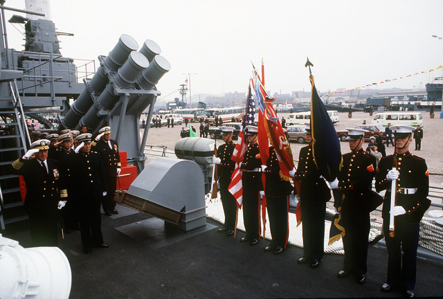 ADM James A. Lyons Jr., Commander In CHIEF of the U.S. Pacific Fleet, and VADM Ma Xin Chun, Commander of the Chinese North Sea Fleet, receive honors on board the guided missile cruiser USS REEVES (CG-24), near a Mark 141 quad Harpoon RGM-84A missile canister. REEVES is part of the first U.S. Navy warship contingent to visit China in forty years