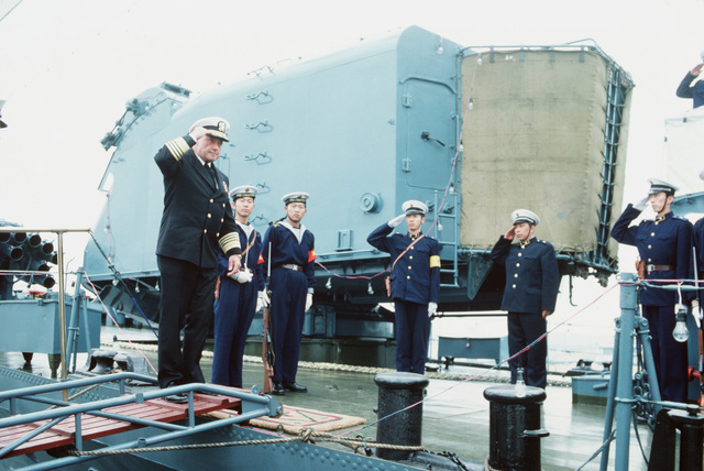 Admiral (ADM) James A. Lyons Jr., commander in chief, US Pacific Fleet, salutes and requests permission to board a Chinese ship. This is the first visit by US Navy (USN) ships to China in 40 years