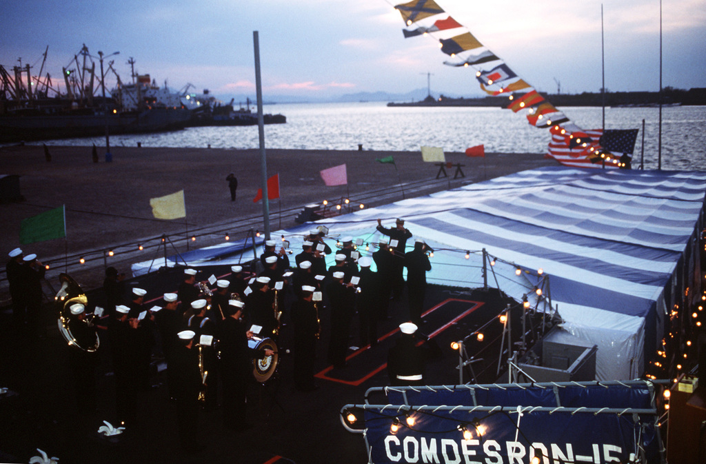 Navy musicians play at a colors ceremony aboard the guided missile cruiser USS REEVES (CG-24) in the harbor. REEVES is part of the first U.S. Navy warship contingent to visit China in forty years