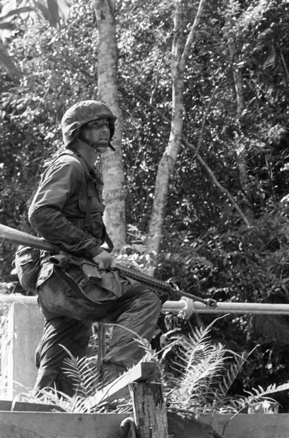 Corporal E. Ramone, a rifle company squad leader with 2nd Battalion, 8th Marines, rests his M16A2 rifle on his thigh as he assesses the surrounding terrain during an exercise in the Northern Training Area