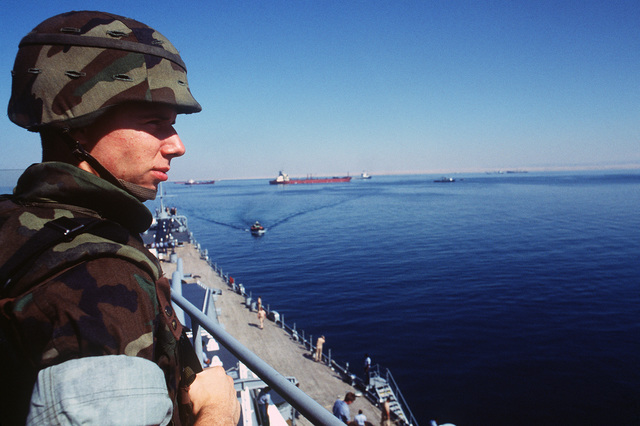 Lance Corporal (LCPL) Shawn Gregory surveys the shore of the Suez Canal from the 05 level of the battleship USS MISSOURI (BB 63).  The ship is en route to Istanbul, Turkey, during an around the world shakedown cruise