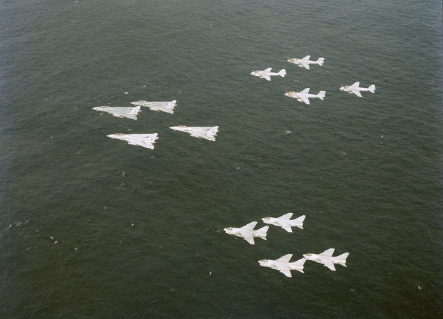 An air to air left side view of F-14A Tomcat, A-7 Corsair II, EA-6B Prowler and A-6 Intruder aircraft flying in formation. The aircraft are part of Carrier Air Wing 8 (CVW-8), deployed from the nuclear-powered aircraft carrier USS NIMITZ (CVN 68)