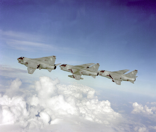 An air-to-air left side view of three Attack Squadron 38 (VA-38) A-7E Corsair II aircraft in formation