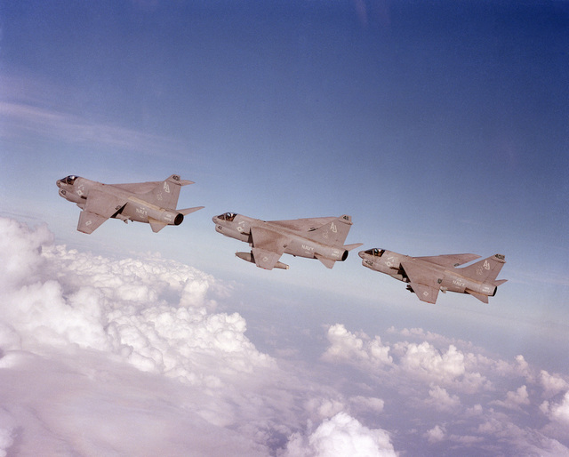 An air to air left side view of three Attack Squadron 38 (VA-38) A-7E Corsair II aircraft in formation