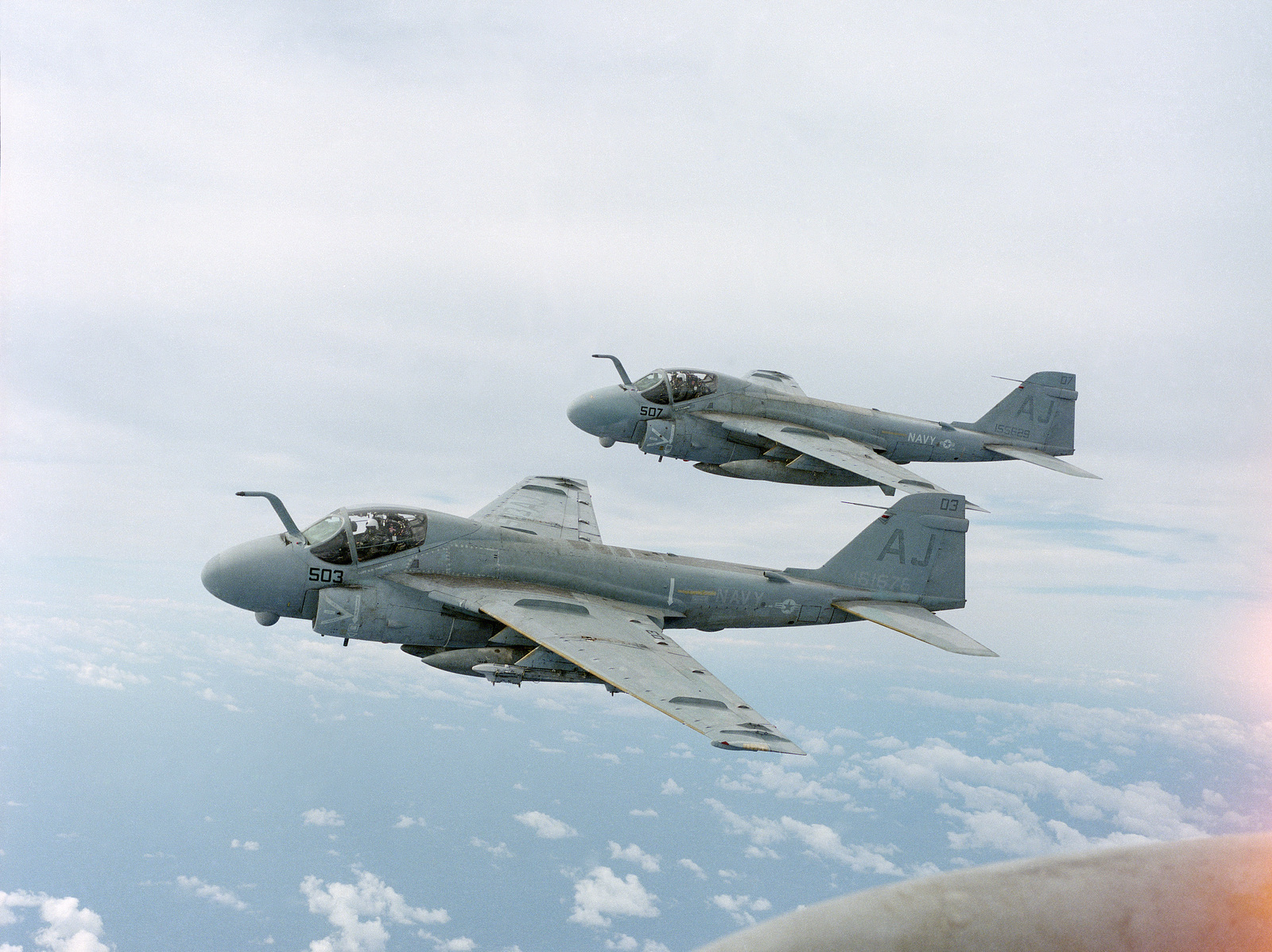 An air to air left side view of two Attack Squadron 35 (VA-35) (VA-35) A-6E Intruder aircraft