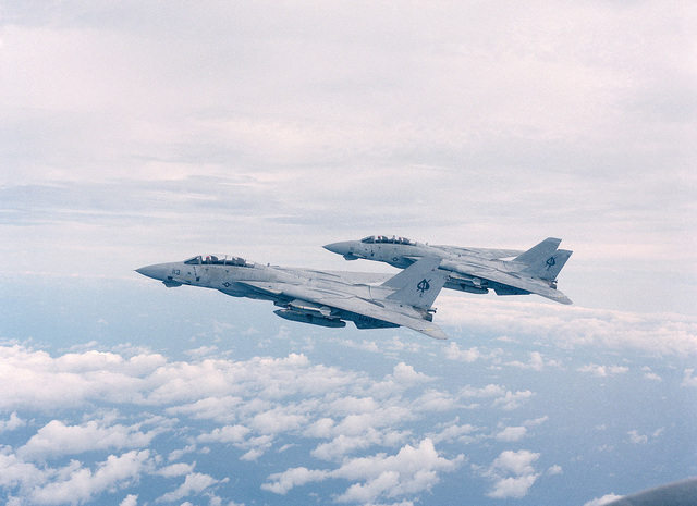 An air to air left side view of two F-14A Tomcat aircraft