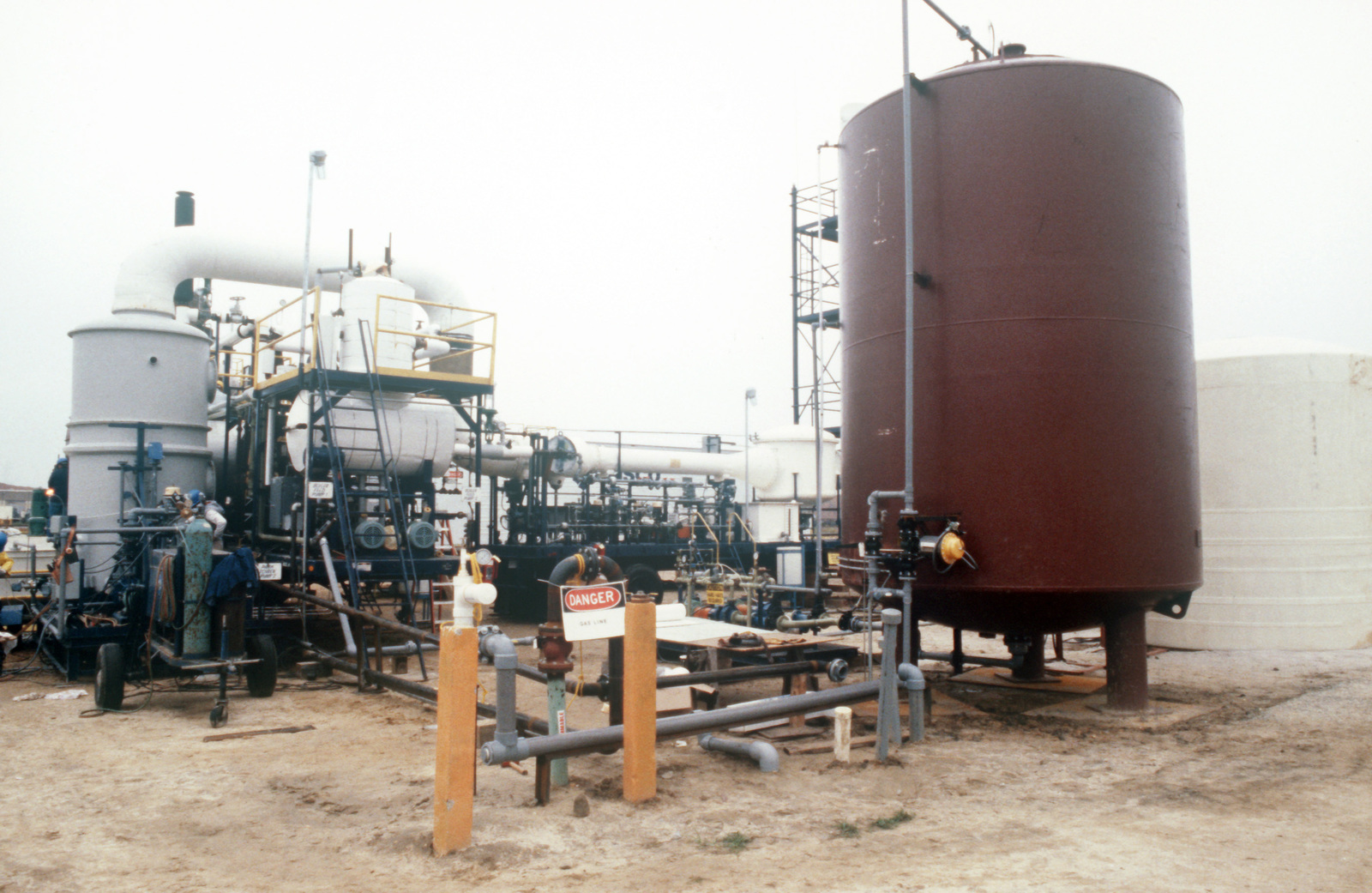 Civilian technicians prepare the dioxin incinerator for operation at the Naval Construction Battalion Center dioxin elimination test site