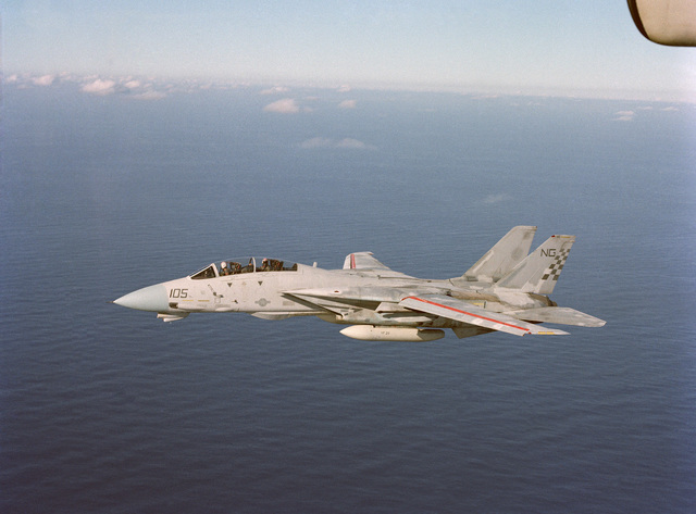 An air-to-air left side view of a Fighter Squadron 21 (VF-211) F-14A Tomcat aircraft