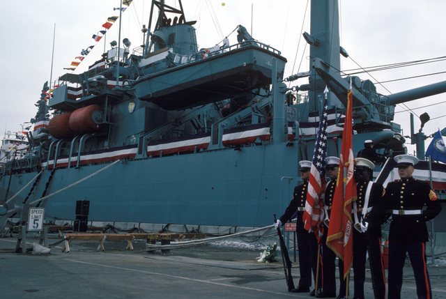 A Marine Corps color guard presents the colors during the commissioning of the savage ship USS GRAPPLE (ARS 53)