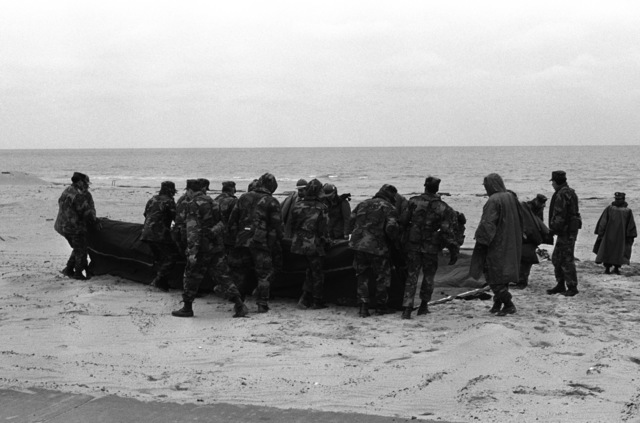 US Navy hospital corpsmen prepare to erect a hospital tent during Exercise SANDCRAB '86