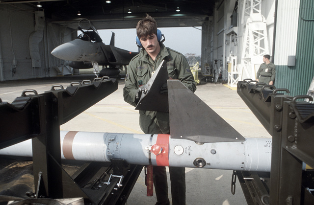 A 48th Fighter Interceptor Squadron technician assembles an AIM-7 Sparrow missile during Exercise AMALGHAM CHIEF '87-1