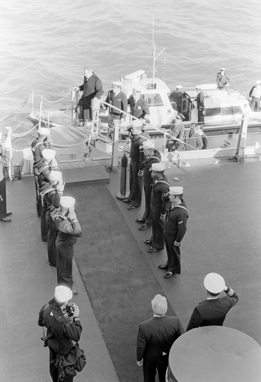 Side boys salute as President Mario Soares of Portugal and Portuguese naval officers come aboard the battleship USS MISSOURI (BB 63)