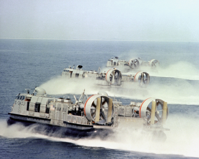 A starboard quarter view of three air cushion landing craft (LCACs) assigned to the Pacific Fleet at Camp Pendleton, Calif., underway in formation