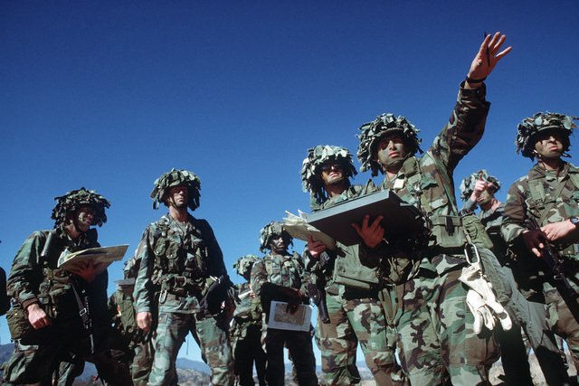 Members of the 7th Infantry Division coordinate attack positions for an offensive prior to the start of the joint US Army/Air Force Exercise CALFEX'86 (combined arms live fire exercise)