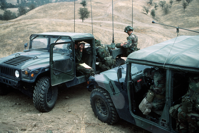 Members of the Tactical Air Control Party coordinate air operations from M998 high-mobility multipurpose vehicles during the joint US Army/Air Force Exercise CALFEX'86 (combined arms live fire exercise)