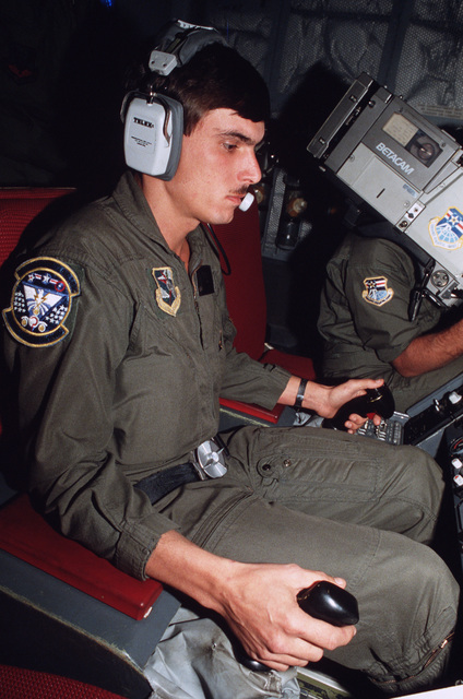 Technical Sergeant (TSGT) Lance M. Hornbuckle, 32nd Aerial Refueling Squadron, operates the fuel boom on board a KC-10 Extender aircraft during an inflight refueling.  The aircraft is participating in Exercise IMMEDIATE FALCON'86