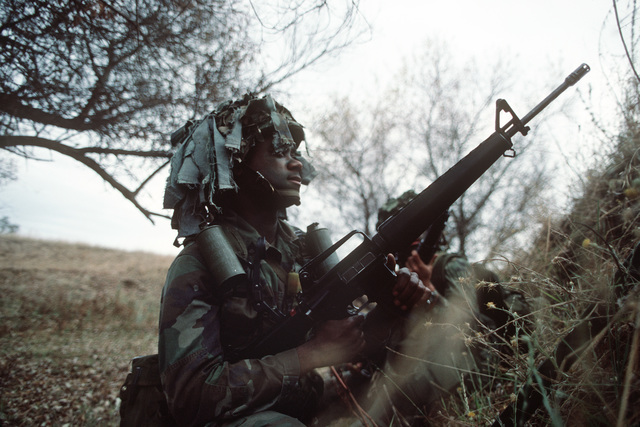 A Soldier of the 7th Infantry Division, armed with an M16A1 rifle, participates in the joint US Army/Air Force Exercise CALFEX'86 (combined arms live fire exercise)